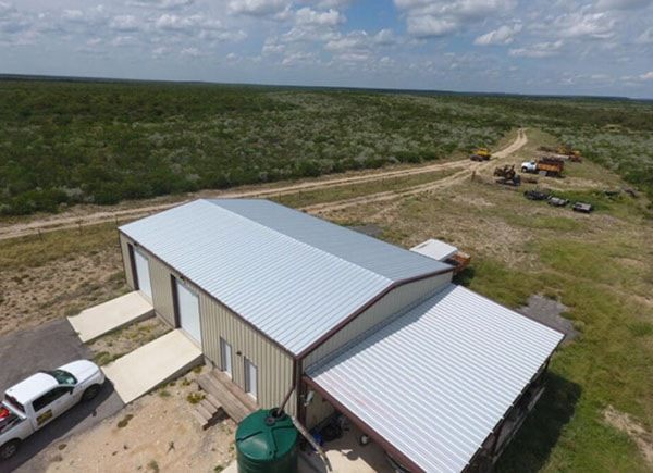 Side view of completed metal roofing project in Central Texas
