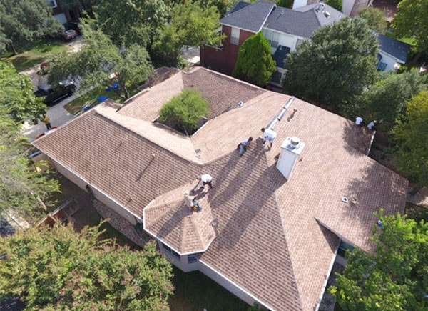 Roofers working on a house in Central Texas